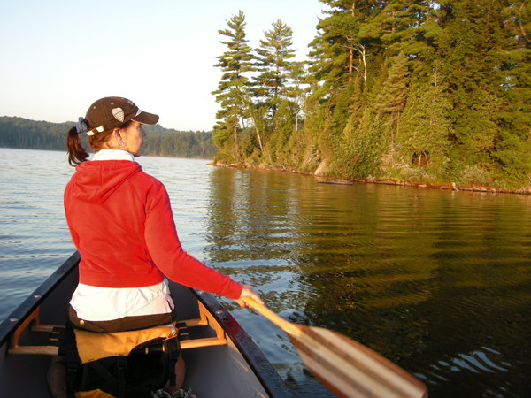 Laura Culic canoing on Kingscote Lake, Algonquin Park
