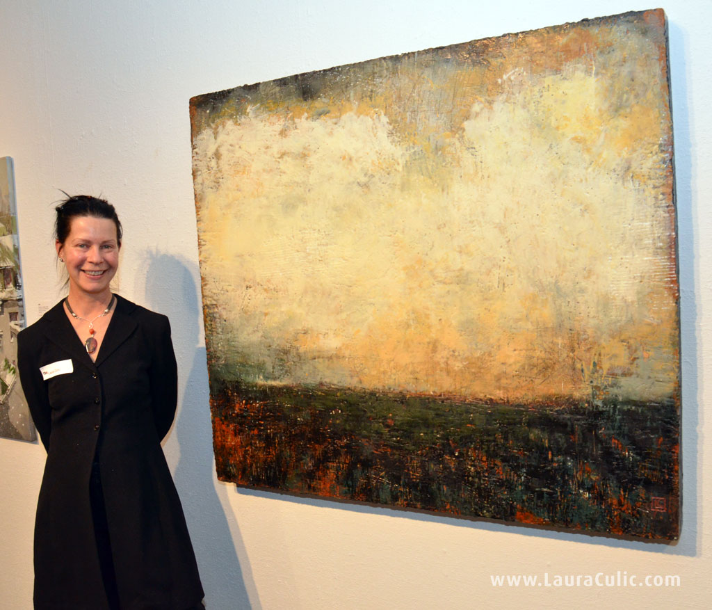 Photo of artist Laura Culic beside painting, December 5, 2013.