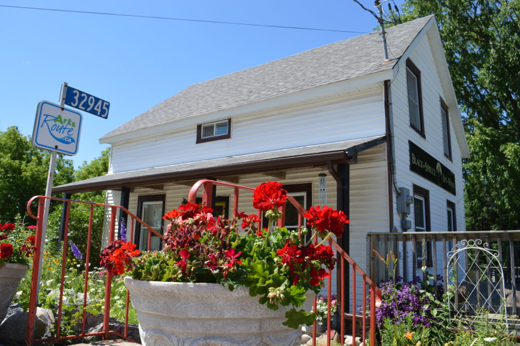 Exterior with flowers, at Black Spruce Art Works, Painter Laura Culic's gallery/Studio in Maynooth, Ontario