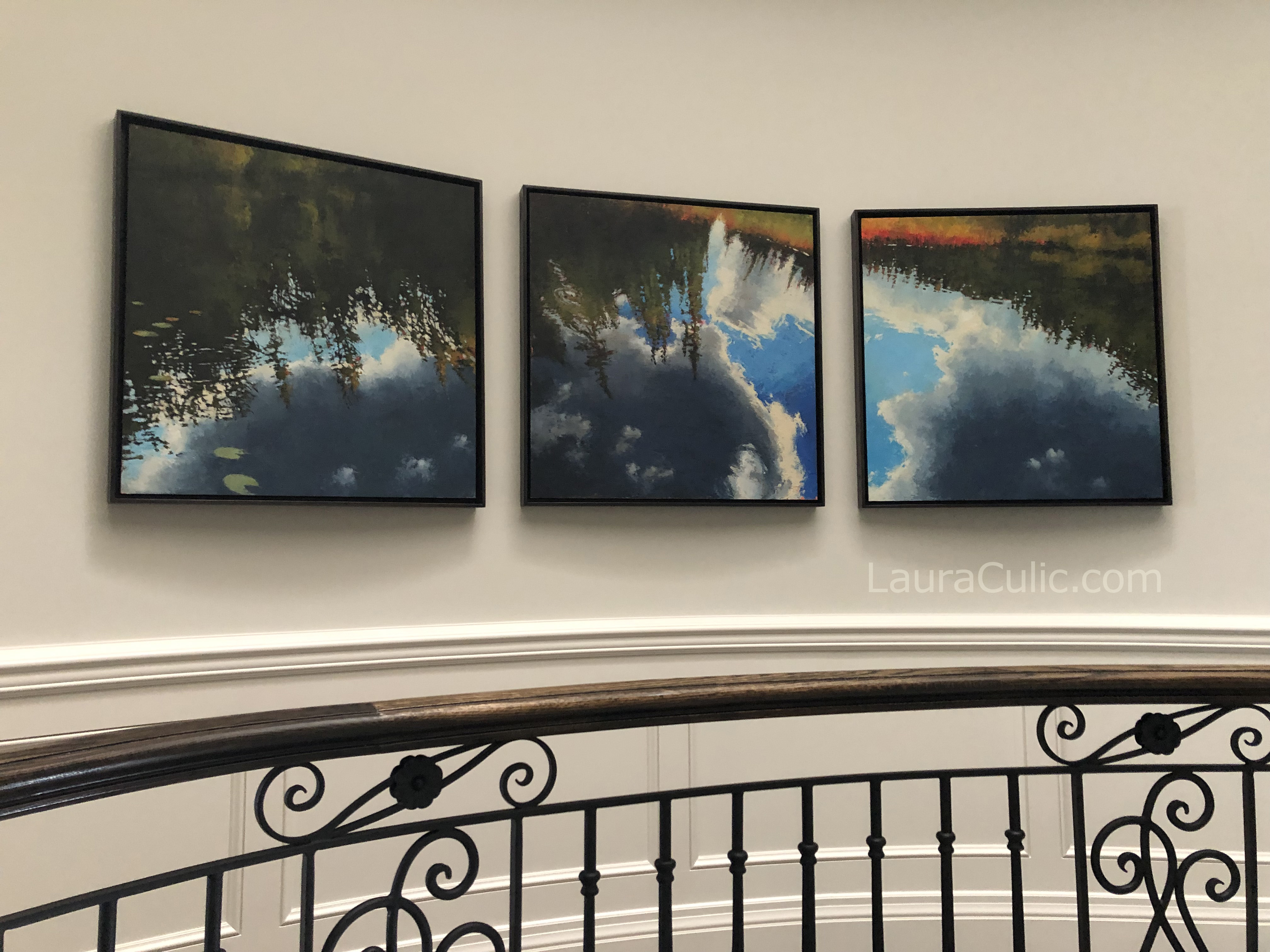 Three paintings of wetlands by Artist Laura Culic hanging on wall