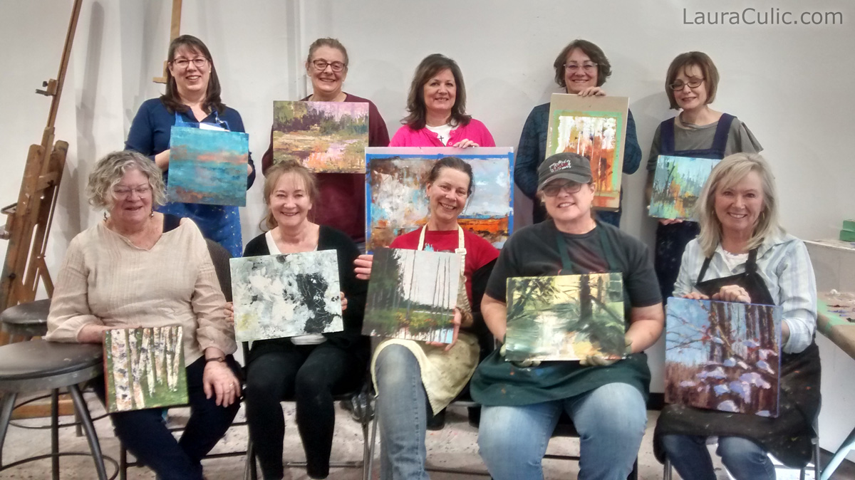 Art students in class by Laura Culic in Calgary, proudly displaying their two-day masterpieces